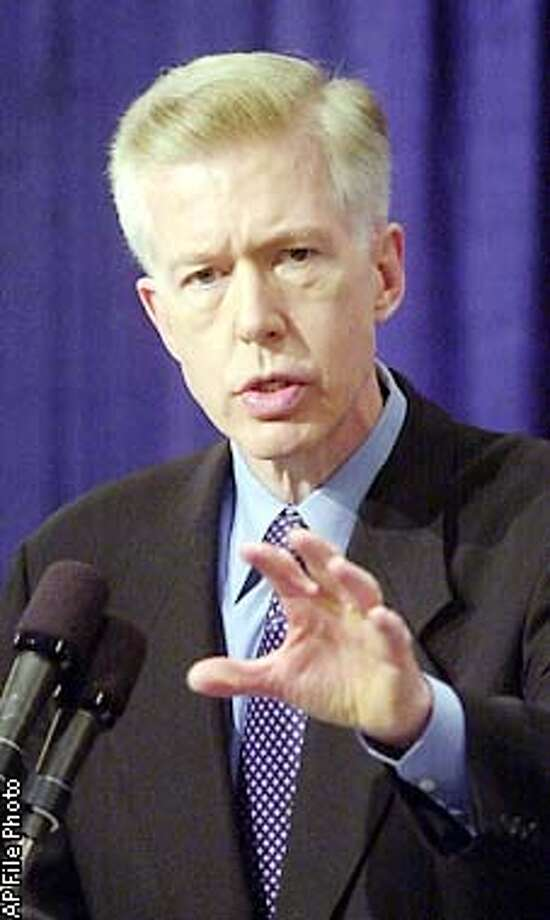 FILE--Gov. Gray Davis defends his record on the budget and energy during an appearance before the Sacramento Press Club, Jan. 23, 2002, in Sacramento, Calif. The state now wants the federal government to help it get out of paying more than $40 billion for electricity it secured through long-term contracts it signed in the midst of its power crisis. Davis, who repeatedly praised the contracts as the best deal the state could get at the time, is facing harsh criticism from consumer groups and even his own appointees over the deals. (AP Photo/Rich Pedroncelli, File) Photo: RICH PEDRONCELLI