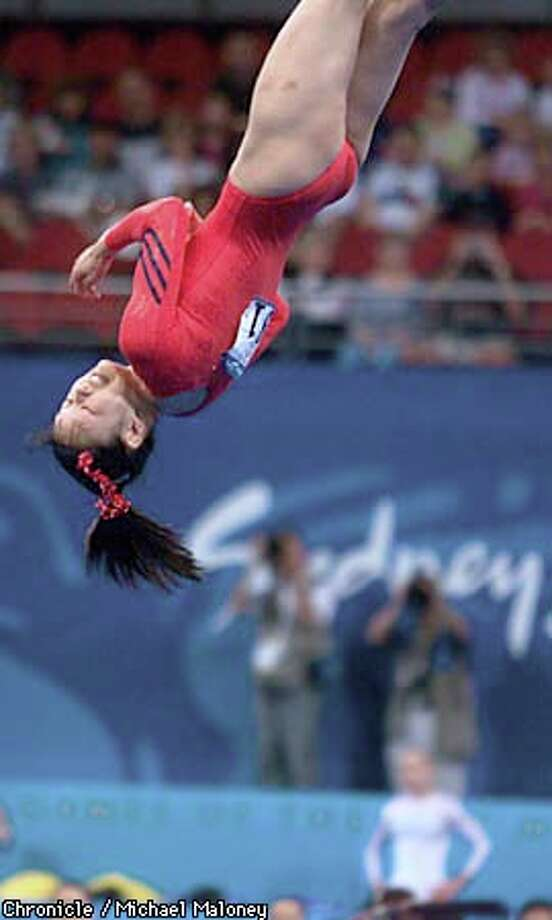 Stanford medical student Amy Chow flipped through the air during her floor routine. Chronicle photo by Michael Maloney