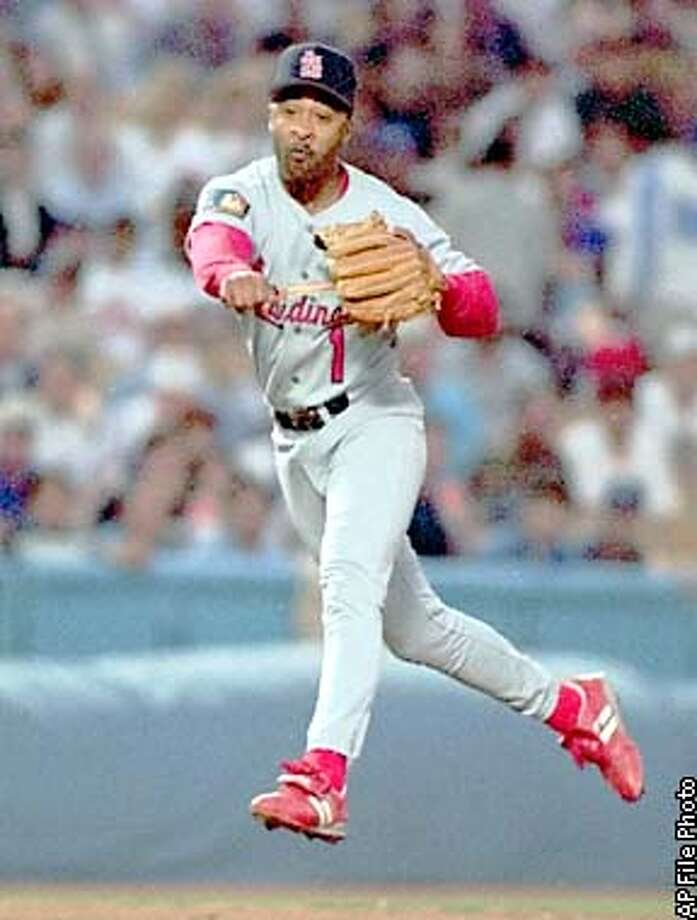 ADVANCE FOR WEEKEND EDITIONS DEC. 29-30--FILE--St. Louis Cardinals' Ozzie Smith throws to put out a Los Angeles Dodger in Los Angeles in this June 12, 1994 photo. On the final weekend of balloting for the baseball Hall of Fame, voters could very well elect a .262 hitter to the shrine in Cooperstown. The question is which one. With just 28 home runs and 793 runs batted in over a 19-year career, Ozzie Smith averaged about 1 and a half home runs and a shade under 41 RBIs per season. But oh, what he coulddo with his glove.(AP Photo/Mark J. Terrill) Photo: MARK J. TERRILL