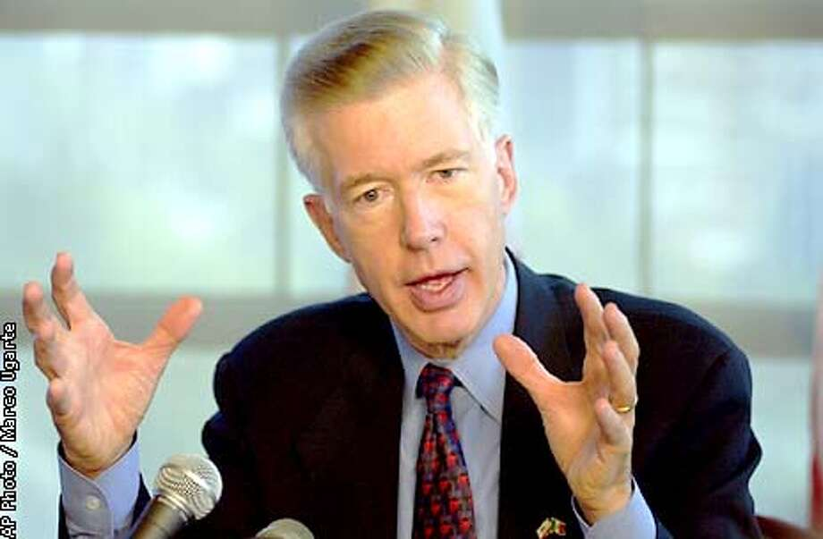 Calif. Gov. Gray Davis talks to the media in Mexico City on Tuesday, Dec. 4, 2001. Davis arrived in Mexico Sunday for a two-day trip meant to reinforce his state's crucial trade ties with its southern neighbor following the Sept. 11 terror attacks. (AP Photo/Marco Ugarte) Photo: MARCO UGARTE