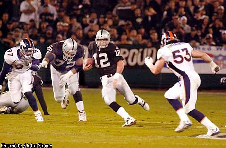 Rich Gannon scrambles up field as Bill Romanowski pursues in the first quarter. The Oakland Raiders take on the Denver Broncos on Monday, November 5, 2001 at Network Associates Coliseum. John Storey/The Chronicle Photo: John Storey