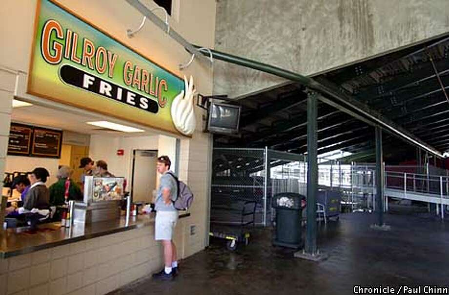 One of the best kept secrets at Pac Bell Park is the garlic fries stand tucked away beneath the center field bleachers.  PAUL CHINN/S.F. CHRONICLE Photo: PAUL CHINN