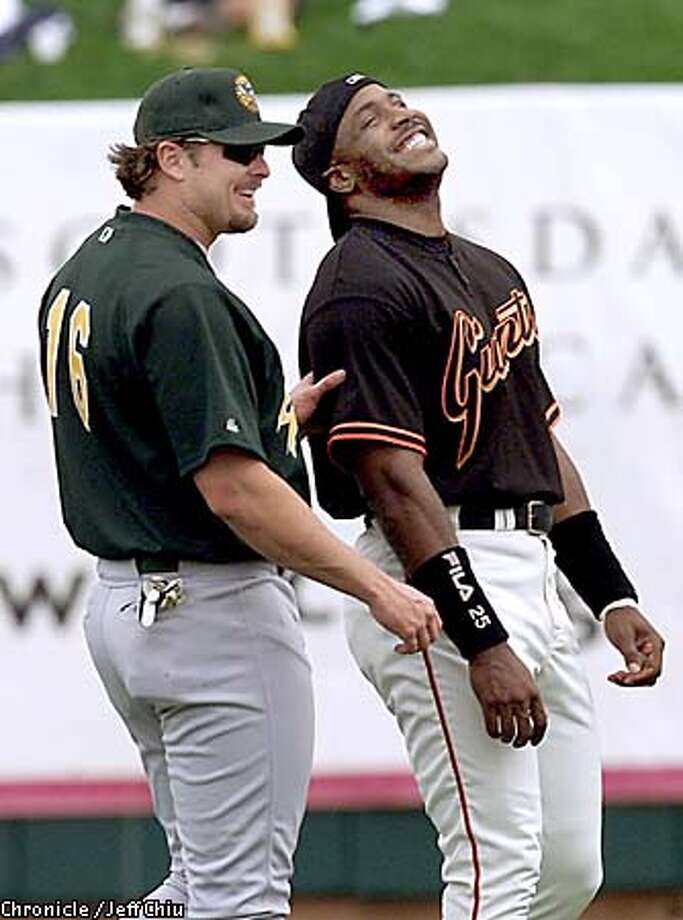 Jason Giambi, left, and Barry Bonds are both talking contract extension, but Giambi's is more likely. Chronicle photo by Jeff Chiu