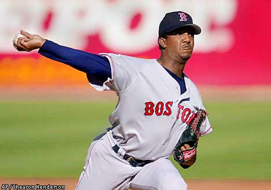 Boston Red Sox starting pitcher Pedro Martinez delivers in the first inning against the Oakland Athletics in Oakland, Calif., Sunday, May 6, 2001. (AP Photo/Thearon Henderson) Photo: THEARON HENDERSON