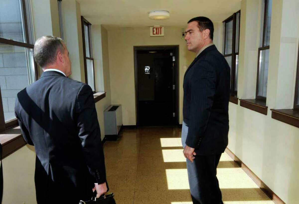 Troy City Councilman Kevin McGrath, right, talks with his attorney Peter Moschetti Jr. after testifying before a Rensselaer County special grand jury investigating ballot fraud at the Rensselaer County Courthouse in Troy, N.Y. Thursday Oct. 6, 2011.( Michael P. Farrell/Times Union archive archive)