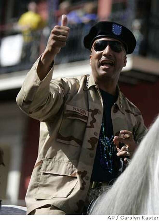 New Orleans Mayor Ray Nagin, dressed as a four-star general, arrives on horseback for Mardi Gras celebrations in Hurricane Katrina-battered New Orleans, Tuesday, Feb. 28, 2006. (AP Photo/Carolyn Kaster) Photo: CAROLYN KASTER