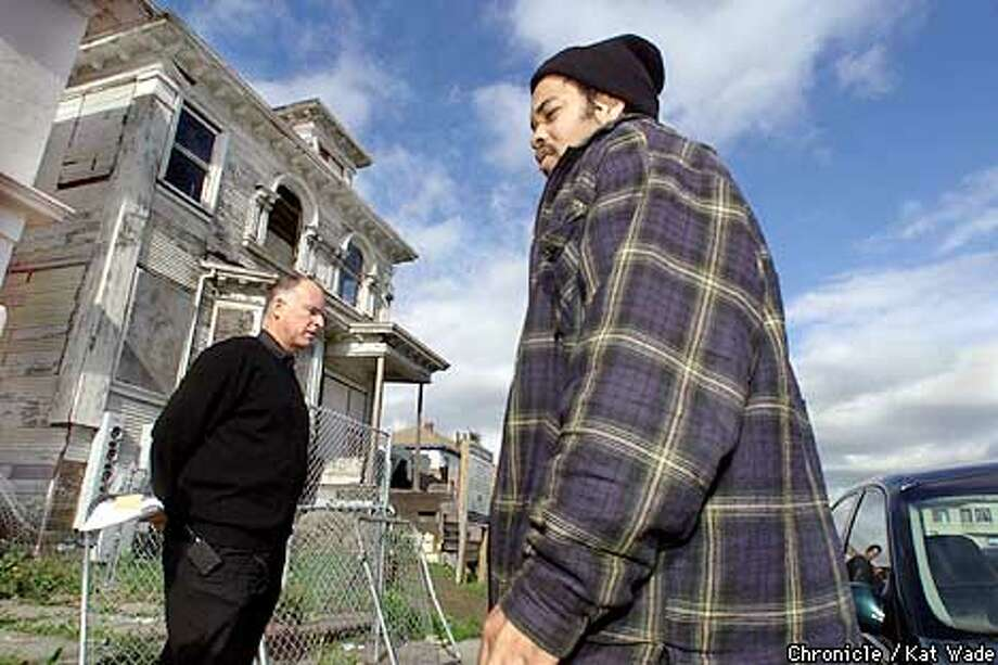 Oakland's Mayor, Jerry Brown talks with Ira Gosby in front of a house that has been posted as a Public Nuissance in the neighborhood of Martin Luther King and 31st Street. Brown has adopted this poor neighborhood that was featured on 60 minutes as a showcase for change. SAN FRANCISCO CHRONICLE PHOTO BY KAT WADE Photo: KAT WADE