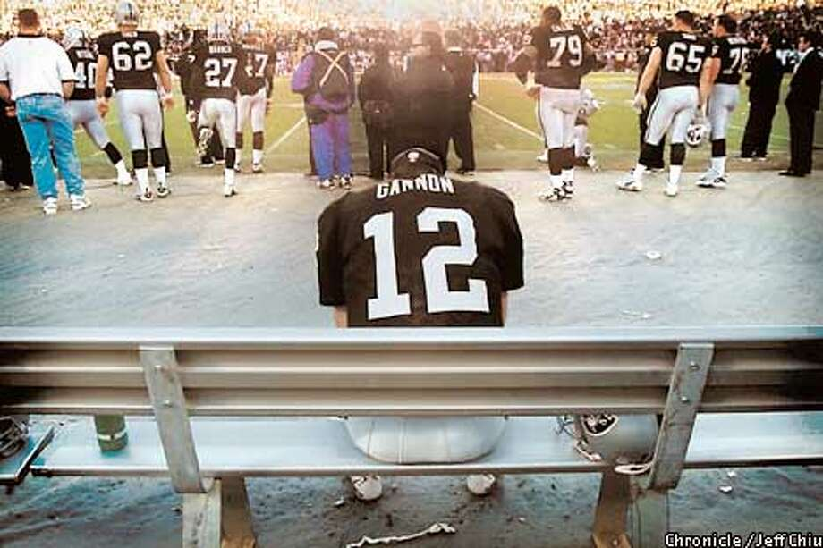 RAIDERGANNON5-14JAN01-SP-JC  Oakland Raiders and the Baltimore Ravens battle for the AFC Championship at the Oakland Coliseum. Jan 14, 2001.  RICH GANNON SITS DEJECTED ON THE BENCH AT THE END OF THE FOURTH QUARTER. PHOTO BY JEFF CHUI/SAN FRANCISCO CHRONICLE Photo: JEFF CHUI