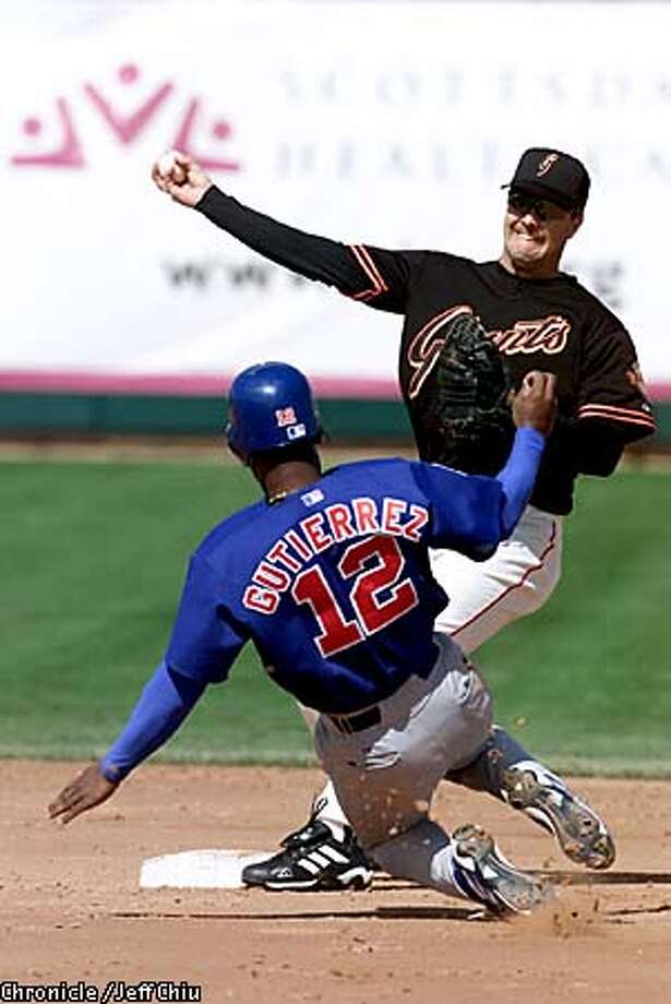 Second baseman Jeff Kent made the out at second on Cubs' shortstop Ricky Gutierrez in the second inning. The Giants lost to the Cubs, 6-5, in the first game of spring training in Scottsdale, AZ, on Thursday. Chronicle photo by Jeff Chiu