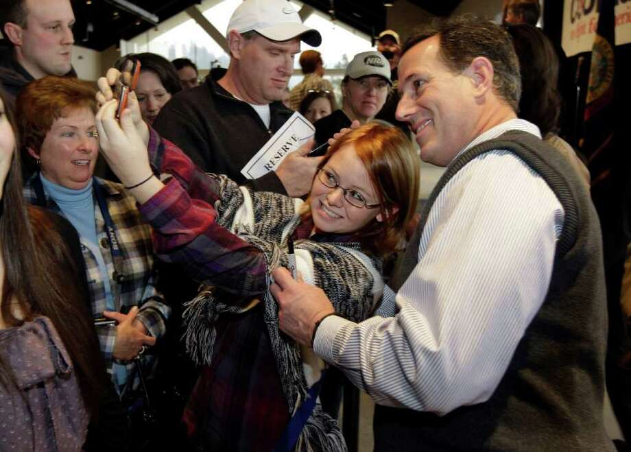 Republican presidential candidate, former Pennsylvania Sen. Rick Santorum poses for a photo with a supporter at a rally, Tuesday, Feb. 14, 2012, in Coeur d'Alene, Idaho. Photo: Ted S. Warren, Associated Press / AP