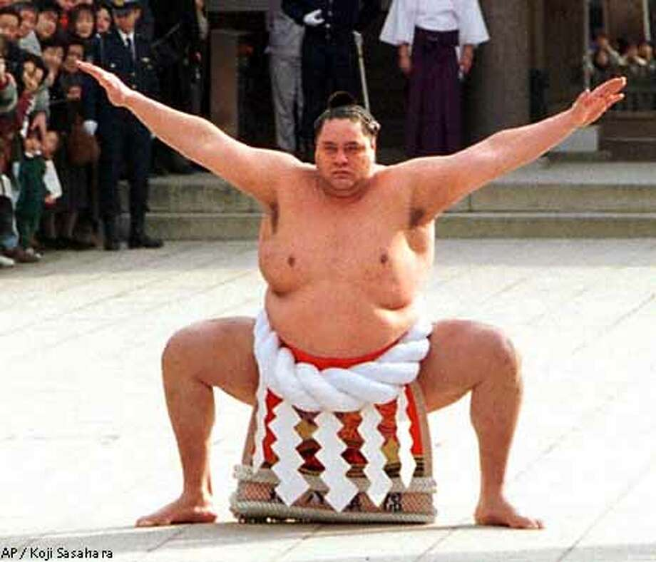 Sumo grand champion Akebono performed the ring-entrance ritual during the annual New Year's dedication at Tokyo's Meiji Shrine January 1997. Associated Press file photo by Koji Sasahara