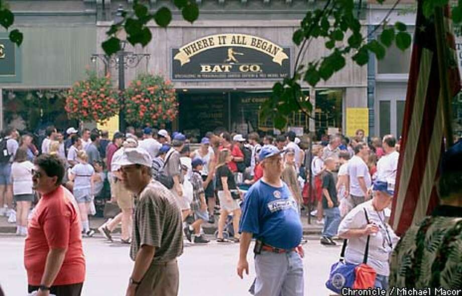 Thousands of fans strolled down Main Street and visited baseball memorabilia shops during Hall of Fame weekend in Cooperstown. Chronicle Photo by Michael Macor.