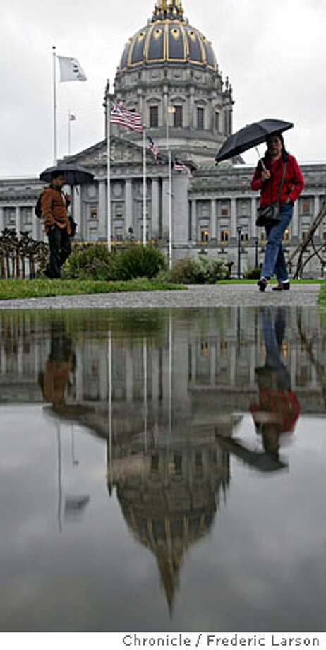 WEATHER_322_fl.jpg As the first major rain storm season arrives people brave the high winds and wet weather outside San Francisco City. 12/1/05 San Francisco CA Frederic Larson San Francisco Chronicle Photo: Frederic Larson