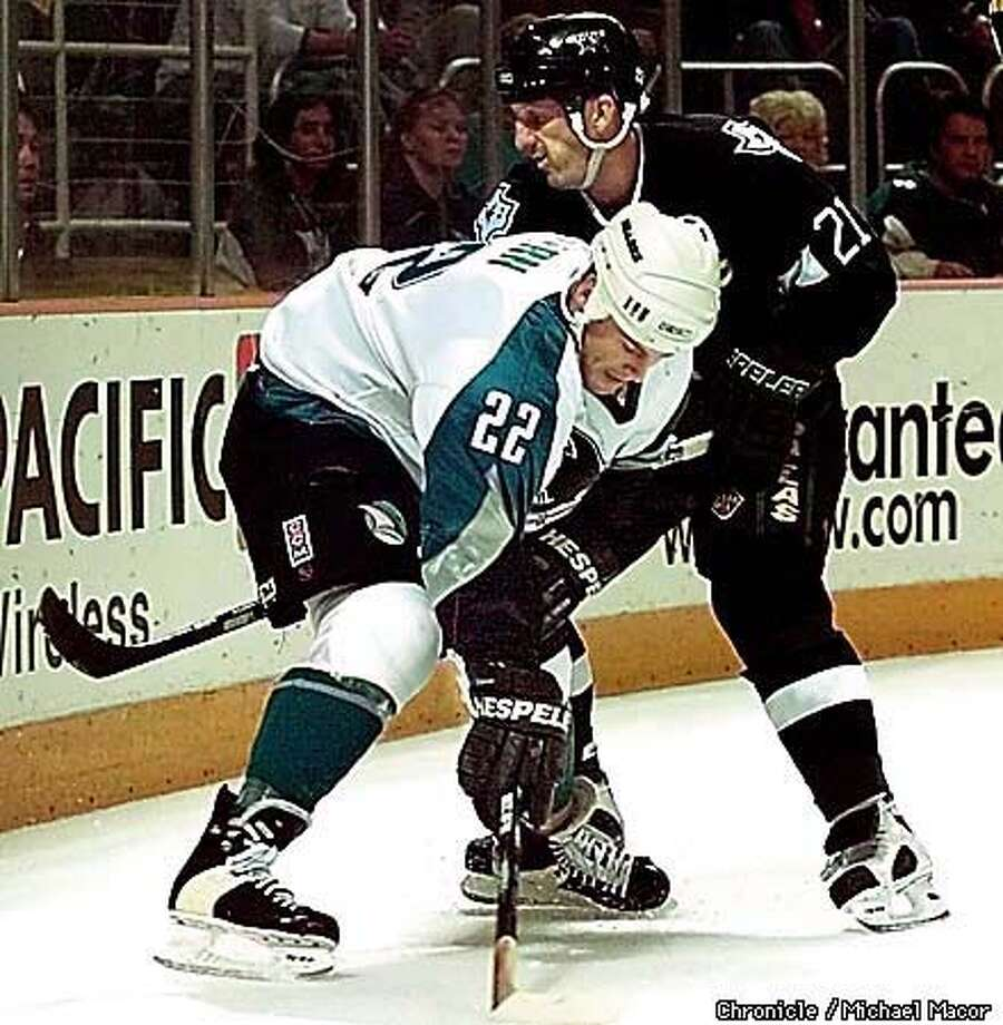 San Jose Sharks vs. Dallas Stars. Sharks 22- Ron Stern and Stars 21- Guy Carbonneau get tangled up behind the stars goal during first half action. by Michael Macor/The Chronicle Photo: MICHAEL MACOR