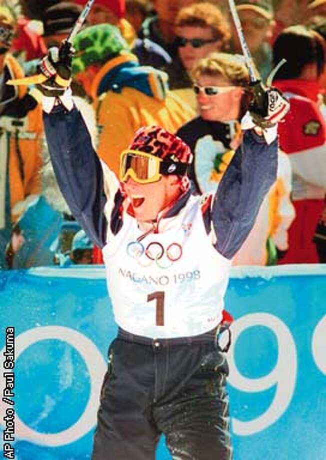 Jonny Moseley of the United States celebrates after winning the Gold Medal Wednesday, Feb.11, 1998, in Men's Moguls at the Winter in Nagano, Japan. (AP Photo/Paul Sakuma) Photo: PAUL SAKUMA