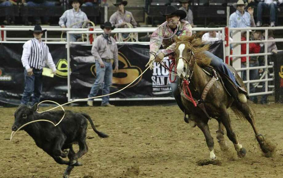 Cuero's Ace Sloan chases down a calf in the tie-down roping competition at the 2012 San Antonio Stock Show & Rodeo on Tuesday, Feb. 14, 2012, taking first in Bracket 3 and a check for $1,965. Photo: Kin Man Hui, San Antonio Express-News / San Antonio Express-News