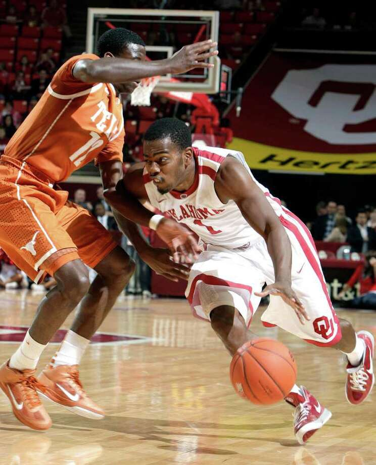 Oklahoma's Sam Grooms (1) tries to get by Texas' Myck Kabongo (12) during an NCAA college basketball game at the Lloyd Noble Center in Norman, Okla., Tuesday, Feb. 14, 2012. (AP Photo/The Oklahoman, Sarah Phipps) TABLOIDS OUT Photo: AP
