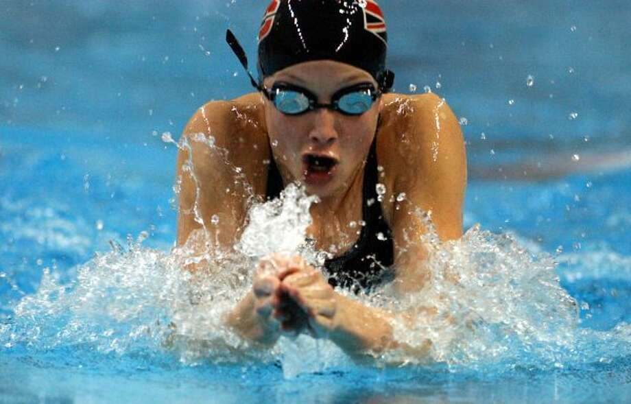 Churchill's Annie Chandler competes in the 100-yard breaststroke at the UIL State 5A Meet Saturday, Feb. 15, 2003 at the Jamail Texas Swim Center.  (File photo / San Antonio Express-News)
