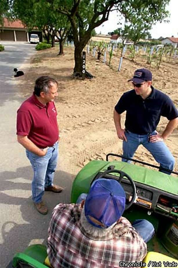 Dwight Meadows (left) and his son Aaron discussed the day's work with Dwight's father, Jesse, on one of their six vineyards in Oakley Chronicle Photo by Kat Wade