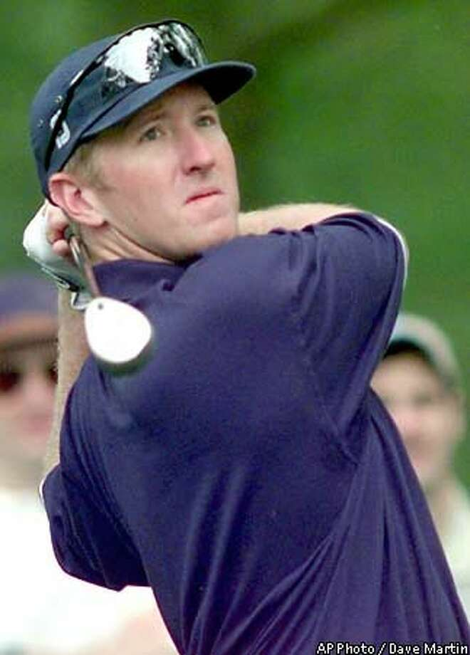 David Duval, from Jacksonville Beach, Fla., follows his shot on  the 7th hole at the Augusta National Golf Club Wednesday, during practice  for the 1999 Masters. AP Photo by Dave Martin