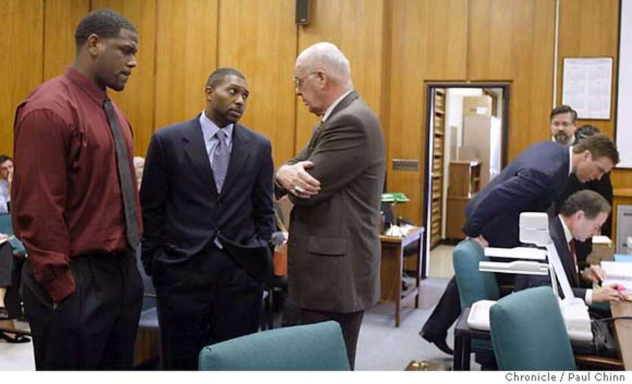 Marcus Williams (far left) huddles with his attorneys Tony West and James Brosnahan while Bill Romanowski talks with his attorney Jeffrey Springer (far right). Opening statements in the civil trial against former Oakland Raiders player Bill Romanowski on 3/1/05 in Oakland, CA. Former teammate Marcus Williams filed a $3.8 million lawsuit against Romanowski after a practice field fight severly injured Williams.  PAUL CHINN/The Chronicle Photo: PAUL CHINN