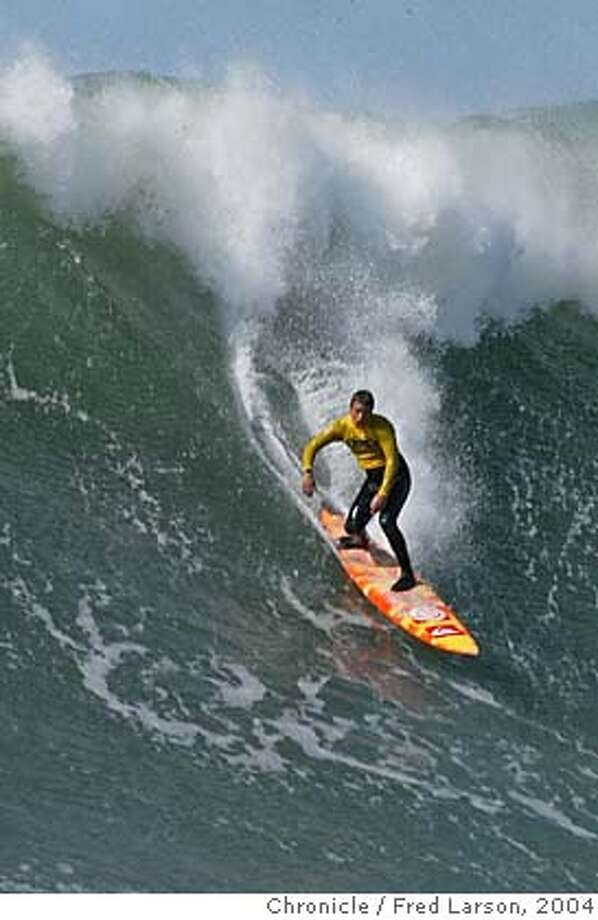 ; A surfer catch 25 foot wave at the Legendary Mavericks surf competition in Half-Moon Bay. City:� 2/27/04, in Half Moon Bay, CA. Frederic Larson/The Chronicle; Photo: Frederic Larson