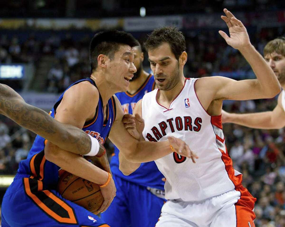 New York Knicks guard Jeremy Lin (17) has the ball stripped as he drives against Toronto Raptors guard Jose Calderon during the first half of an NBA basketball game in Toronto on Tuesday, Feb. 14, 2012. (AP Photo/The Canadian Press, Frank Gunn)
