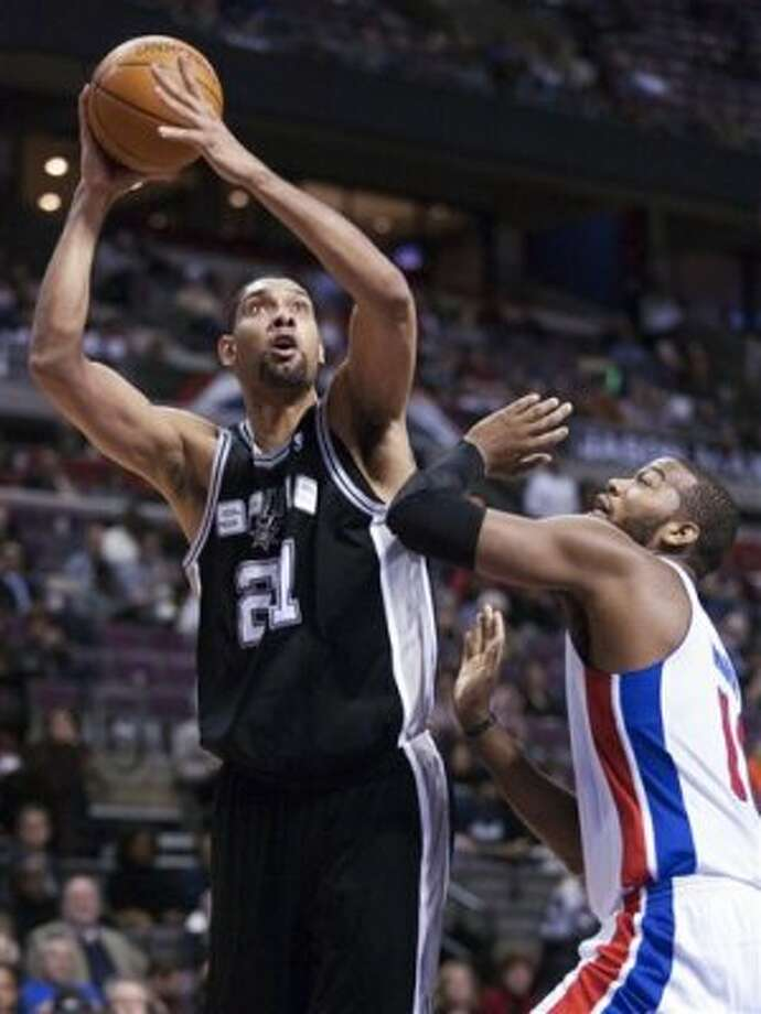 San Antonio Spurs' Tim Ducan (21) takes a shot against Detroit Pistons' Greg Monroe in the first half of an NBA basketball game Tuesday, Feb. 14, 2012, in Auburn Hills, Mich. (AP Photo/Duane Burleson) (AP)