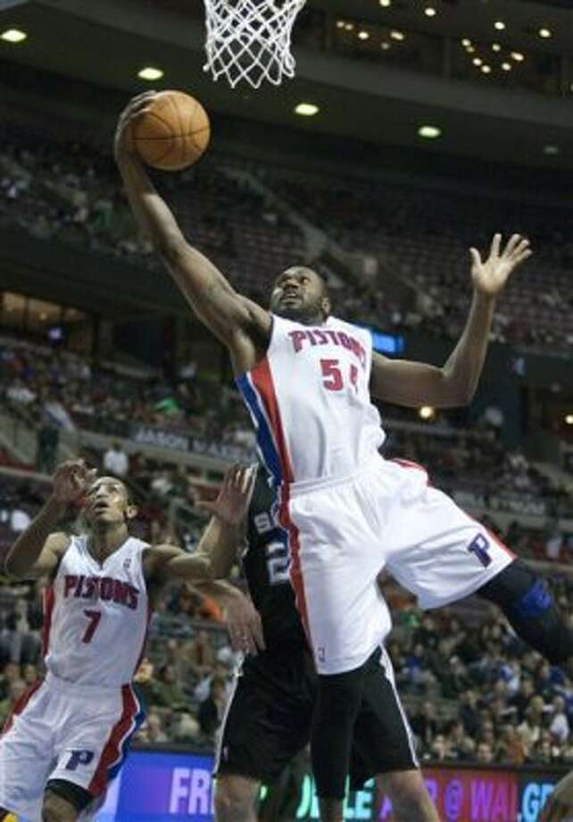 Detroit Pistons' Jason Maxiell (54) grabs a defensive rebound as teammate Brandon Knight (7) looks on in the first half of an NBA basketball game against the San Antonio Spurs on Tuesday, Feb. 14, 2012, in Auburn Hills, Mich. (AP Photo/Duane Burleson) (AP)