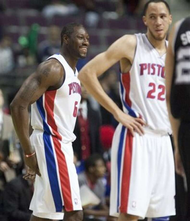 Detroit Pistons' Ben Wallace, left, smiles as he enters the NBA basketball game against the San Antonio Spurs with teammate Tayshuan Prince (22) in the second quarter Tuesday, Feb. 14, 2012, in Auburn Hills, Mich. Wallace has now played in 1,055 games, the most games played by an undrafted player since the 1976-77 NBA-ABA merger. (AP Photo/Duane Burleson) (AP)
