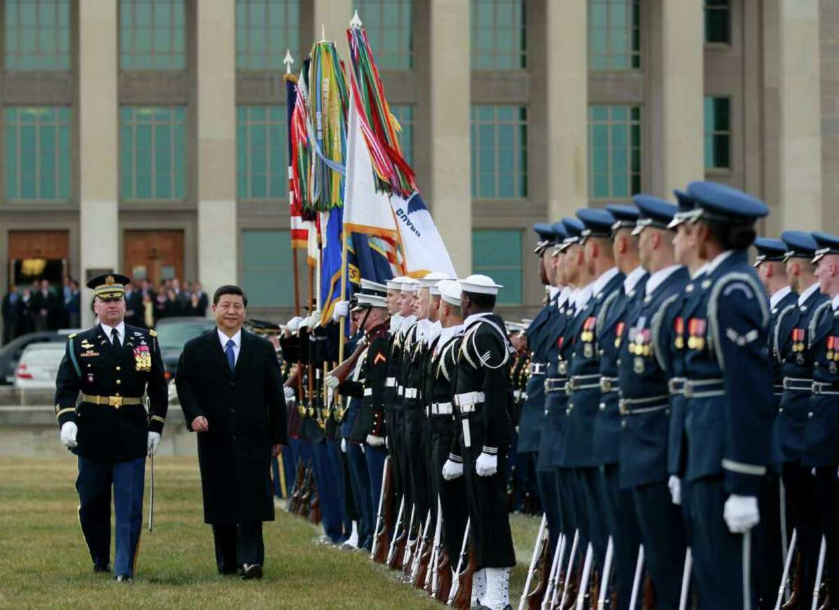 Chinese Vice President Xi Jinping reviews the troops during a full honors ceremony in his honor, Tuesday, Feb. 14, 2012, at the Pentagon. (AP Photo Manuel Balce Ceneta)