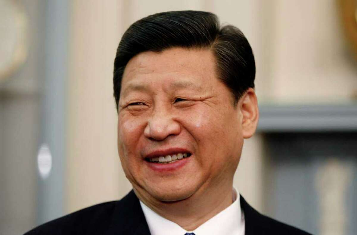 Chinese Vice President Xi Jinping smiles during his meeting with Secretary of State Hillary Rodham Clinton at the State Department in Washington, Tuesday, Feb. 14, 2012. (AP Photo/Charles Dharapak)