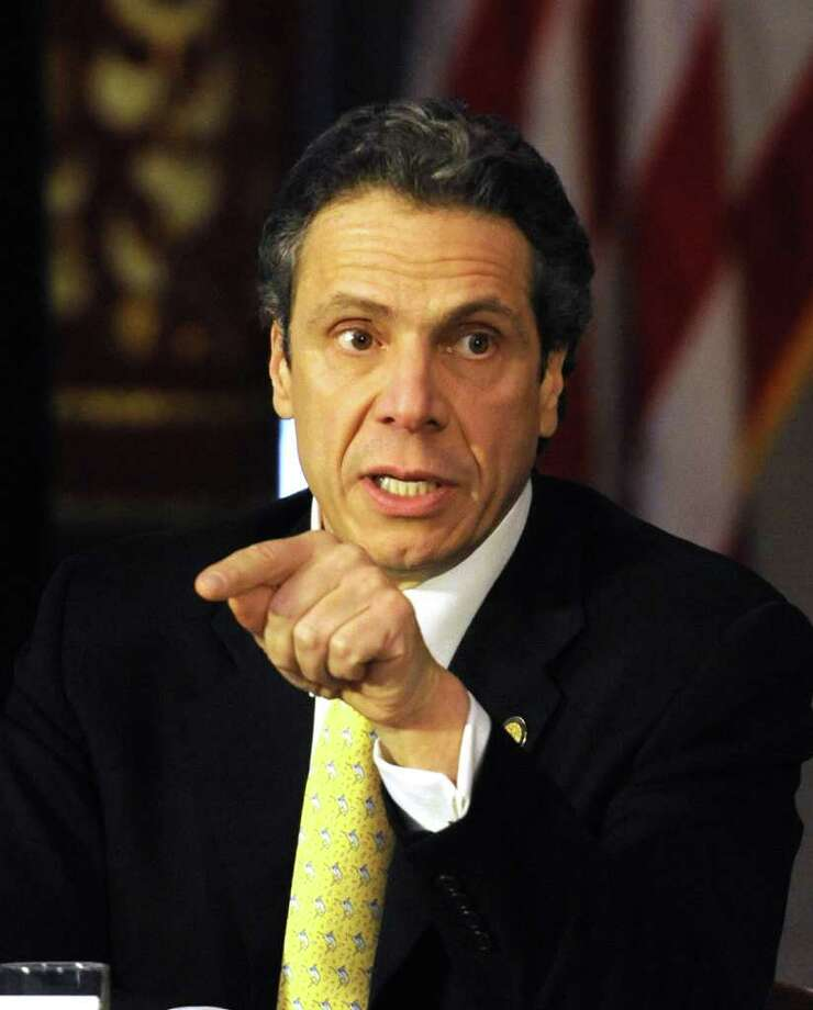 Governor Andrew Cuomo during a Feb. 14, 2012 cabinet meeting at the Capitol in Albany.  Cuomo reminded lawmakers that if a deal isn?t reached by the April 1 budget deadline he could simply put the reform in a temporary ?extender? bill that would allow the state to remain open absent a completed spending plan. ( Skip Dickstein/Times Union archive) Photo: Skip Dickstein