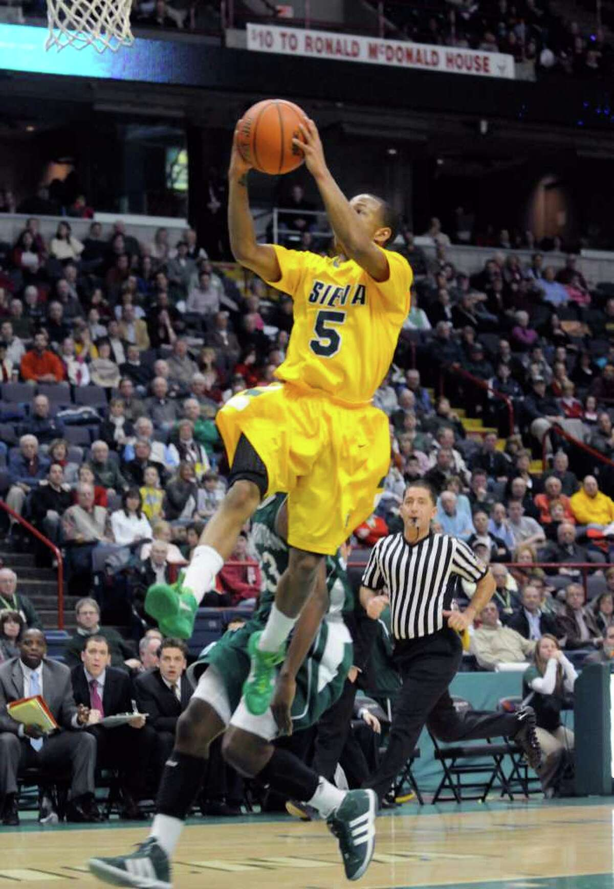 Siena's Evan Hymes goes in for a score during their mens college basketball game against Manhattan at the Times Union Center in Albany, New York Tuesday Feb.14, 2012.( Michael P. Farrell/Times Union)