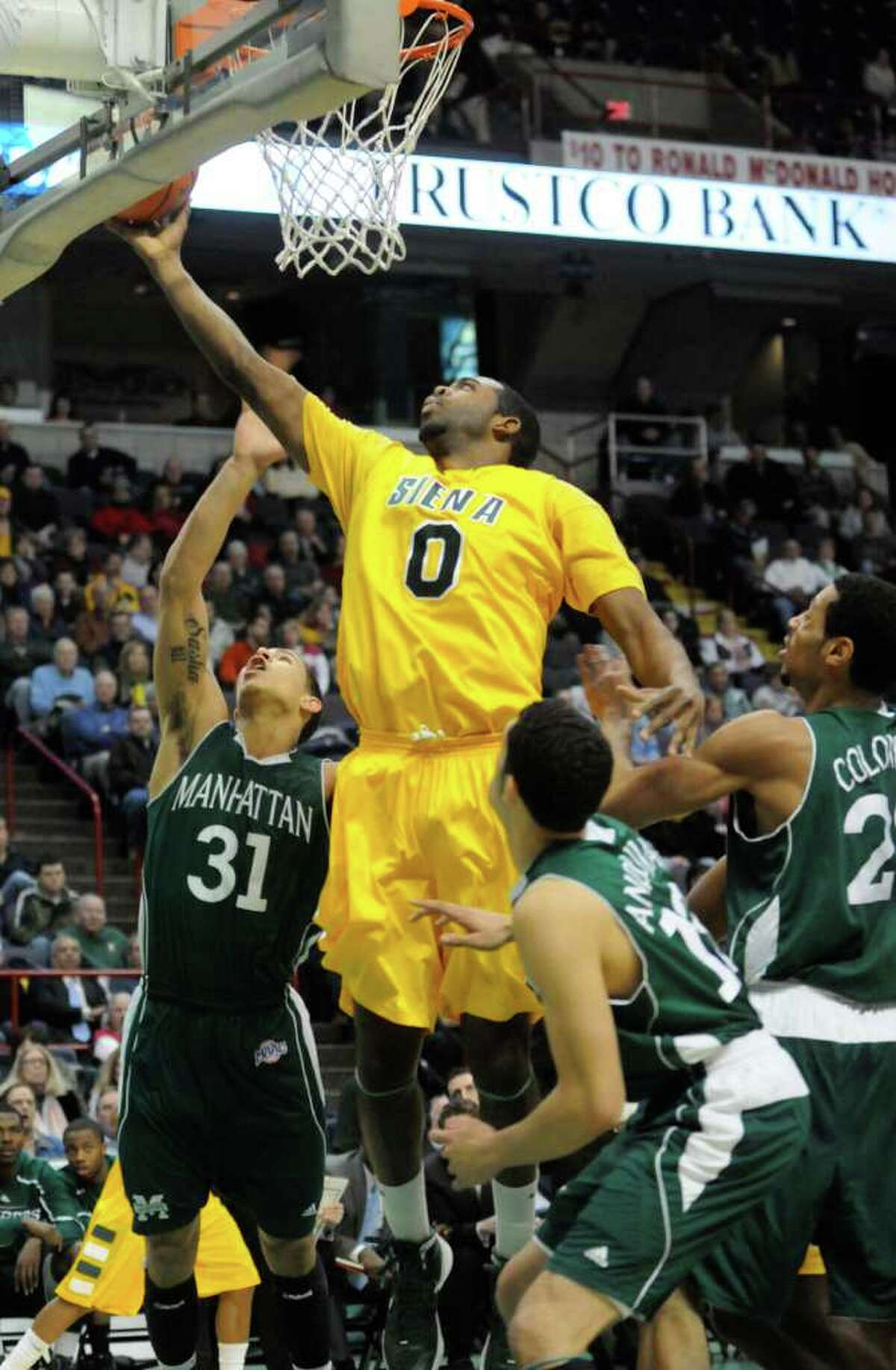 Siena's Brandon Walter drives to the basket during their mens college basketball game against Manhattan at the Times Union Center in Albany, New York Tuesday Feb.14, 2012.( Michael P. Farrell/Times Union)