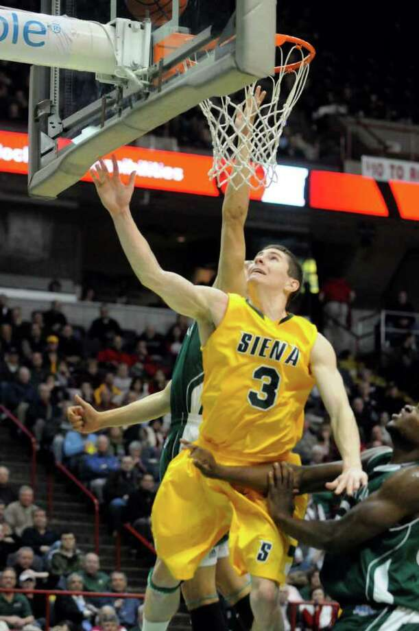 Siena's Kyle Downey goes in for a score during their mens college basketball game against Manhattan at the Times Union Center in Albany, New York Tuesday Feb.14, 2012.( Michael P. Farrell/Times Union) Photo: Michael P. Farrell