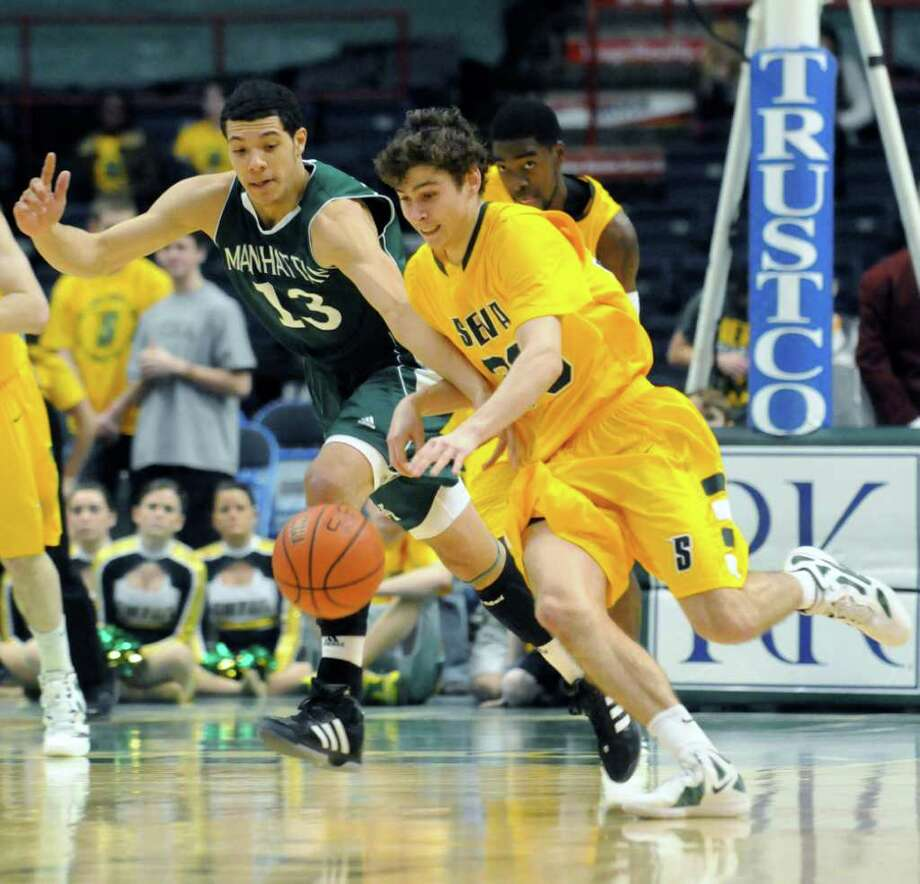 Siena's Rob Poole battles Manhattan's Emmy Andujar for the ball during their mens college basketball game at the Times Union Center in Albany, New York Tuesday Feb.14, 2012.( Michael P. Farrell/Times Union) Photo: Michael P. Farrell