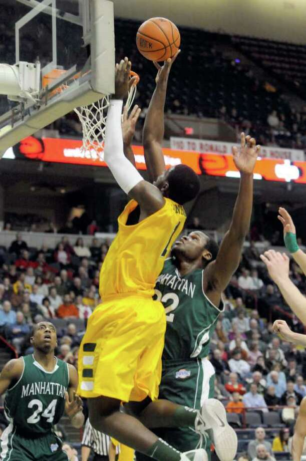 Siena's OD Anosikie drives to the basket during their mens college basketball game against Manhattan at the Times Union Center in Albany, New York Tuesday Feb.14, 2012.( Michael P. Farrell/Times Union) Photo: Michael P. Farrell