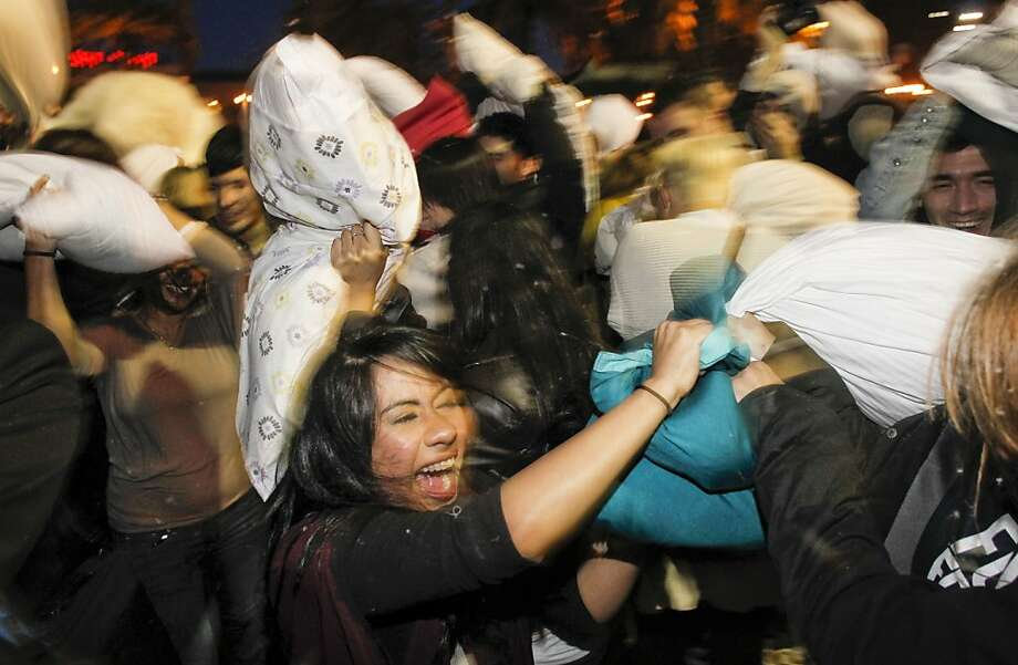 Participants swing away during the Great San Francisco Valentine's Day Pillow Fight on Tuesday Feb. 14, 2012, in San Francisco, Ca., at Justin Herman Plaza. Hundreds of people get together for a good old-fashioned pillow fight. It's the seventh year the City has hosted the pillow fight, which is held in part, to help people get out their Valentine's aggressions in a safe and healthy manner. Photo: Michael Macor, SFC
