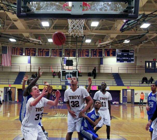 Liam Testo, of Troy High School, front left, reaches for the rebound at the Albany High School vs. T