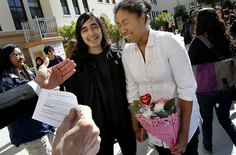 "Salvador Martinez smiled as his bride Iealis Williams (right) got the giggles during their ""marriage"" at the event. Gallileo High School in San Francisco, Calif. held their annual ""love fest"" on Valentine's Day.  It's done for student educational purposes and acceptance of the Gay Straight Alliance. Photo: Brant Ward, The Chronicle"