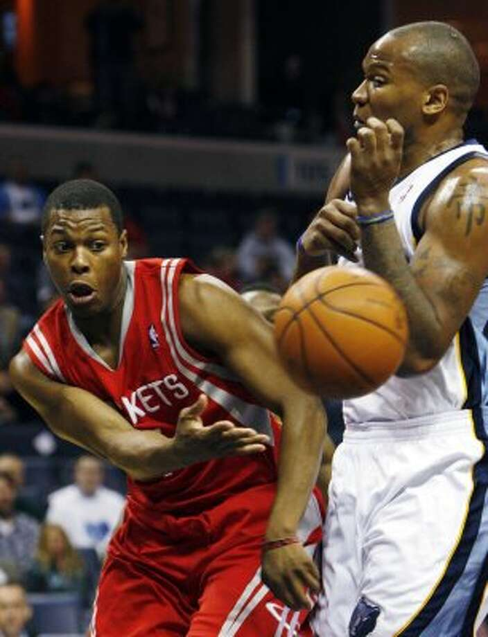 Grizzlies forward Marreese Speights, right, defends Rockets guard Kyle Lowry in the first half. (Alan Spearman / Associated Press)