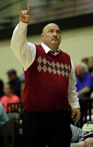 New Braunfels Canyon head coach Terry Tennell reacts positively to a foul call against Kerrville Tivy during a girls' basketball Class 4A playoff game at Littleton Gymnasium on Tuesday, Feb. 14, 2012. MICHAEL MILLER / mmiller@express-news.net Photo: Michael Miller, Express-News / © 2012 San Antonio Express-News