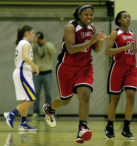 New Braunfels Canyon's Chamaya Turner celebrates after defeating Kerrville Tivy during a girls' basketball Class 4A playoff game at Littleton Gymnasium on Tuesday, Feb. 14, 2012. New Braunfels Canyon won 54-45, with Turner scoring 13 points. MICHAEL MILLER / mmiller@express-news.net Photo: Michael Miller, Express-News / © 2012 San Antonio Express-News