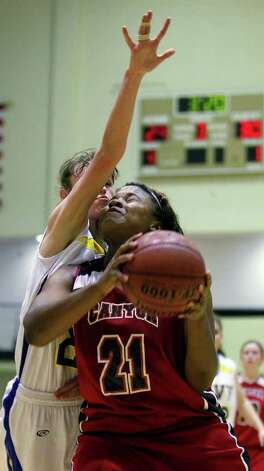 New Braunfels Canyon's Chamaya Turner (21) is fouled by Kerrville Tivy's Olivia Robertson during a girls' basketball Class 4A playoff game at Littleton Gymnasium on Tuesday, Feb. 14, 2012. New Braunfels Canyon won 54-45. MICHAEL MILLER / mmiller@express-news.net Photo: Michael Miller, Express-News / © 2012 San Antonio Express-News