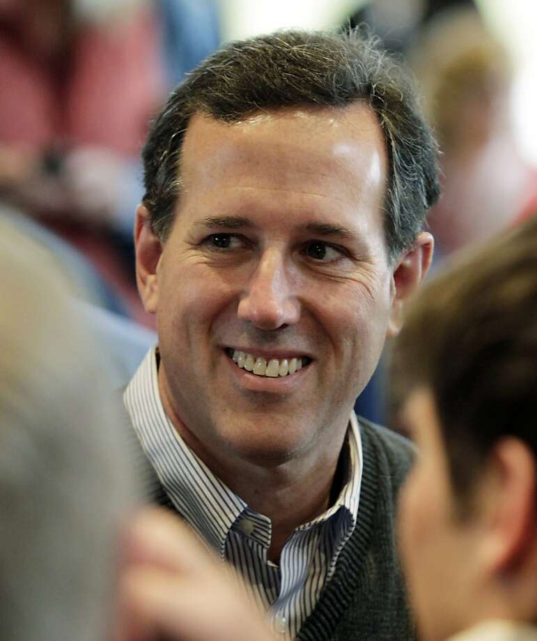 Republican presidential candidate, former Pennsylvania Sen. Rick Santorum, smiles as he greets supporters after speaking at a rally, Tuesday, Feb. 14, 2012, in Coeur d'Alene, Idaho. Photo: Ted S. Warren, Associated Press