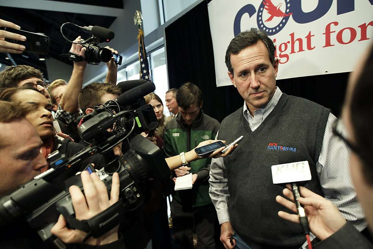 Republican presidential candidate, former Pennsylvania Sen. Rick Santorum, takes questions from reporters after speaking at a rally, Tuesday, Feb. 14, 2012, in Coeur d'Alene, Idaho.