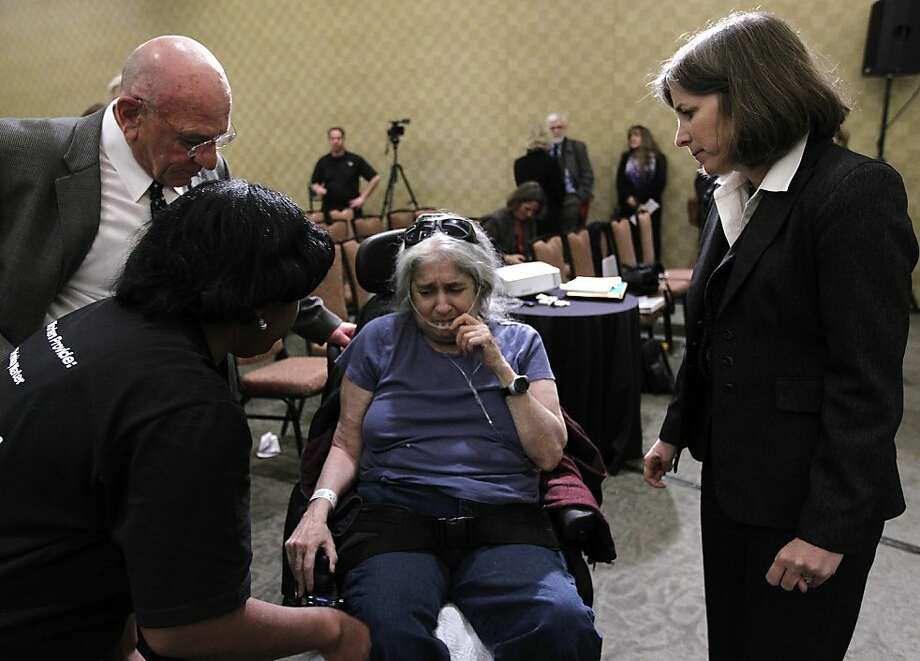 John Thomas, chief operating officer of the San Mateo County Medical Center, and Lisa Mancini (right), director of Aging and Adult Services, try to comfort Esther Nord in Millbrae, Calif. on Tuesday, Feb. 14, 2012 after the Board of Supervisors voted unanimously to close the Burlingame Long-Term Care facility. Photo: Paul Chinn, The Chronicle