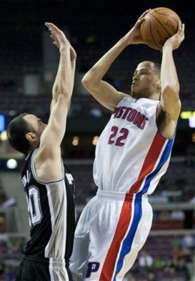 Detroit Pistons' Tayshaun Prince (22) takes a shot against San Antonio Spurs' Manu Ginobili in the second half of an NBA basketball game Tuesday, Feb. 14, 2012, in Auburn Hills, Mich. The Spurs defeated the Pistons 99-95. (AP Photo/Duane Burleson) (AP)