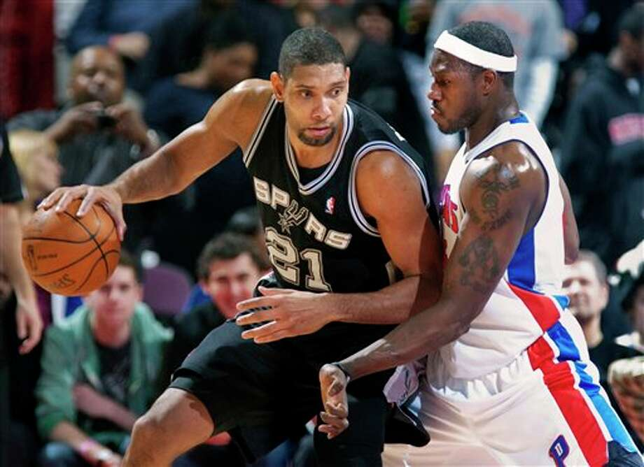 Detroit Pistons' Ben Wallace, right, puts pressure on San Antonio Spurs' Tim Duncan in the second half of an NBA basketball game Tuesday, Feb. 14, 2012, in Auburn Hills, Mich. The game was the 1,055th of Wallace's career, the most games played by an undrafted player since the 1976-77 NBA-ABA merger. The Spurs defeated the Pistons 99-95. (AP Photo/Duane Burleson) (AP)